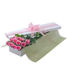 Caixa de rosas cor-de-rosa